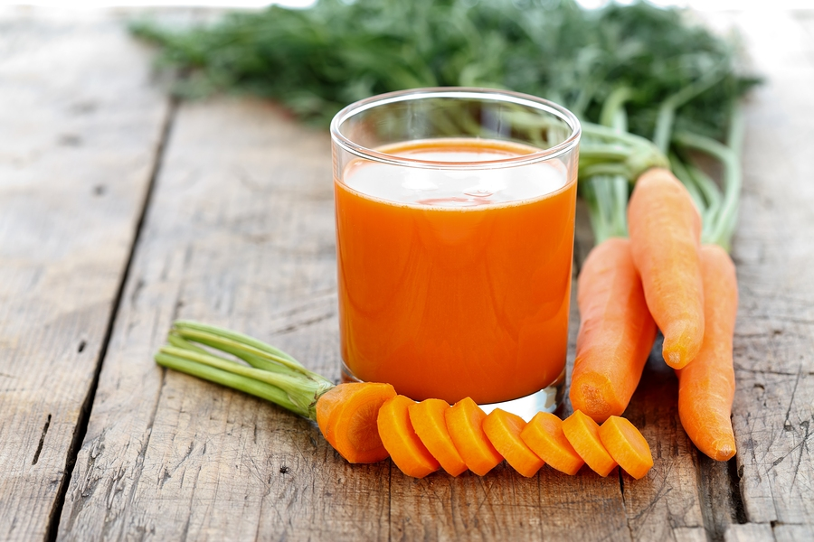 Fresh smoothie with carrots on a wooden table